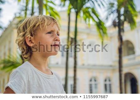 Boy on background of Old Town Hall in George Town in Penang, Malaysia. The foundation stone was laid Stock photo © galitskaya