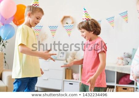 Deux cute peu garçons anniversaire jouer Photo stock © pressmaster