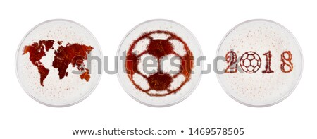 Glasses of red ale beer with world football shape Stock photo © DenisMArt