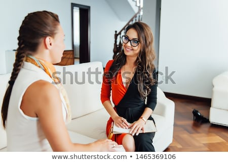 Smiling woman talking with a coach to find the motivation to achieve the goals of financial success Stock photo © ruslanshramko
