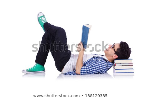 Cheerful young student standing holding book and reading, classm Stock photo © Freedomz