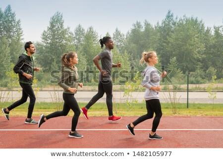 Oldalnézet négy fiatal fut lefelé elvesz Stock fotó © pressmaster