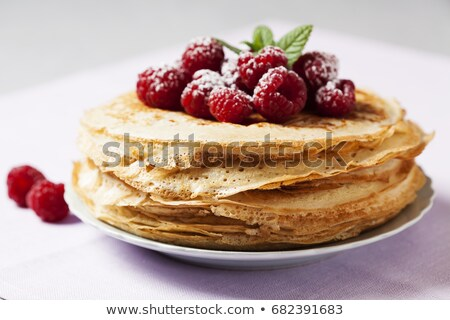 Stack of crepes with raspberries Stock photo © Alex9500