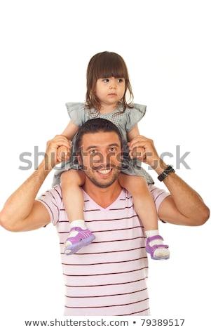 gelukkig · jonge · familie · een · kind · holding · handen - stockfoto © lopolo