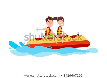 man and woman sitting on inflatable banana boat stock photo © robuart