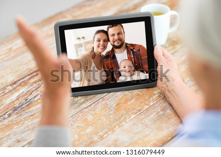 boy with tablet computer having video chat at home Stock photo © dolgachov