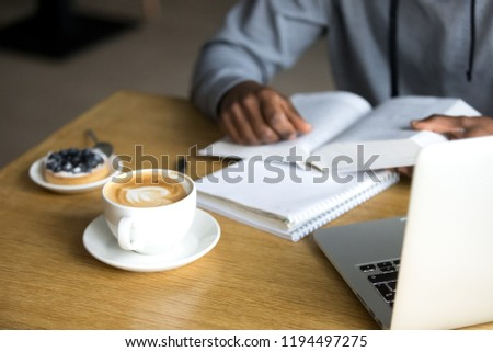 Man Read Book in Coffeehouse and Drink Coffee Stock photo © robuart