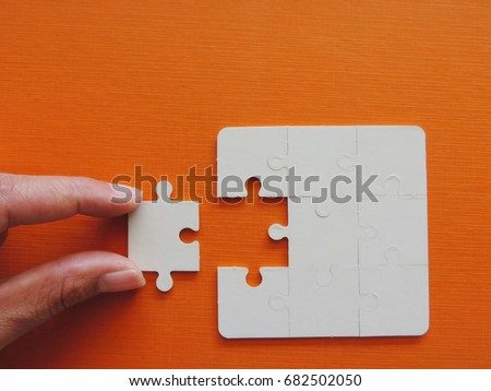 Hand Holding a Piece of a Puzzle Stock photo © Nelosa