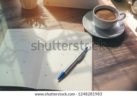 pen and diary or planner on white stock photo © jarin13