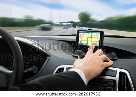 Businessman pointing a car interior Stock photo © wavebreak_media
