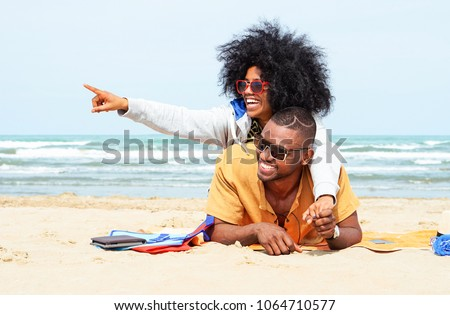 friends in sunglasses having fun on tropical beach Stock photo © dolgachov