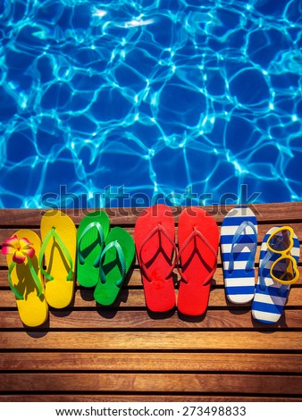Színes papucs úszómedence csíkos család divat Stock fotó © ivonnewierink