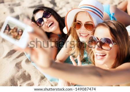 Selfie summer beach vacation travel girl taking self-portrait photo with phone on sun tan holiday. W Stock photo © Maridav