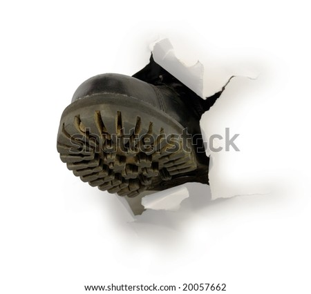 male black boot in hole of paper stock photo © pzaxe