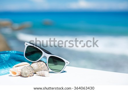 The black sunglasses lying on a beach Stock photo © acidgrey