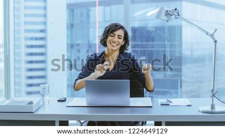 Happy businesswoman using laptop at her desk Stock photo © wavebreak_media