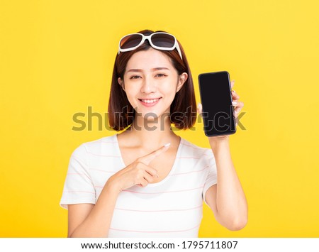 Young woman showing a smart phone Stock photo © bmonteny