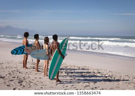 вид сбоку молодые мужчины Surfer доска для серфинга Сток-фото © wavebreak_media