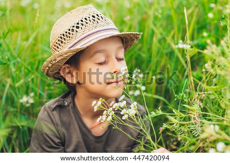 boy and flowers meadow Stock photo © Paha_L