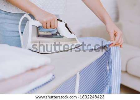 Closeup of a woman ironing Stock photo © photography33