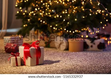 wrapped christmas present Stock photo © LightFieldStudios