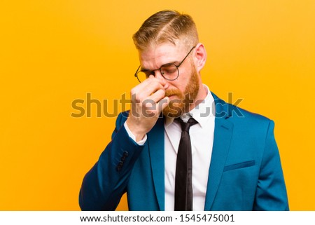 young sick and unhappy businessman isolated on white background stock photo © elnur