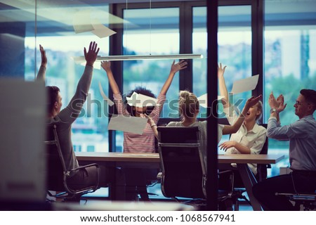business team celebrating success at night office stock photo © dolgachov
