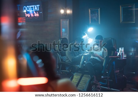 Young Woman Getting Tattoos In Beauty Parlor With Tattooist Working Stock photo © diego_cervo