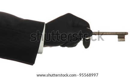 Hand With Black Rubber Glove With Old Rusty Key Stock fotó © pterwort