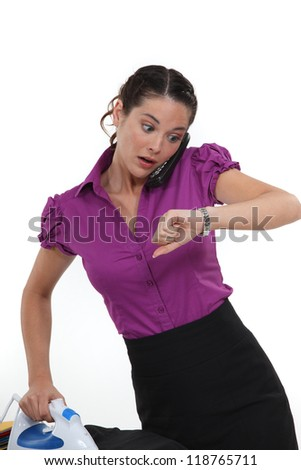 A working woman frantically looking at the time Stock photo © photography33