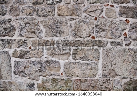 Eski taş duvar bir beton yol duvar Stok fotoğraf © trgowanlock