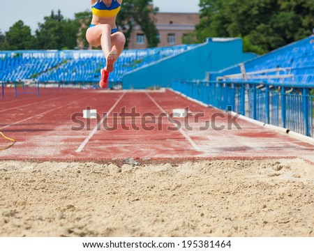 execution of the triple jump Stock photo © OleksandrO