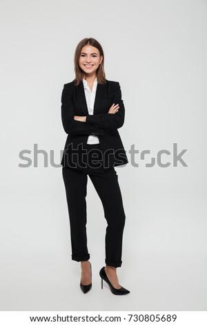 Elegant young businesswoman posing. Stock photo © NeonShot