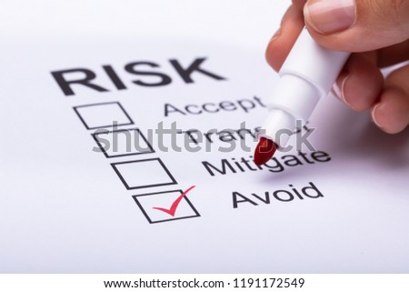 Woman Ticking Avoid Option On Risk Form Stock photo © AndreyPopov
