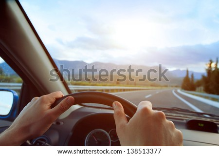 Hands of a driver on a wheel of a car  Stock photo © lightpoet