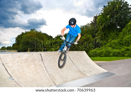 boy has fun with his BMX at the skatepark Stock photo © meinzahn
