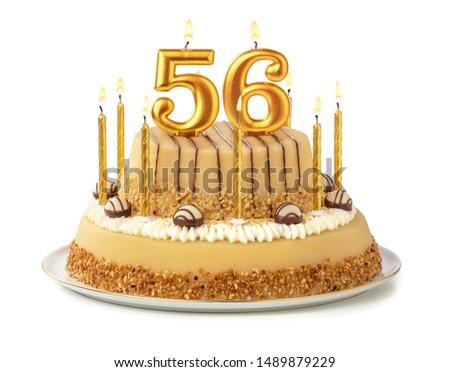 Birthday cake with burning candle number 56 Stock photo © Zerbor
