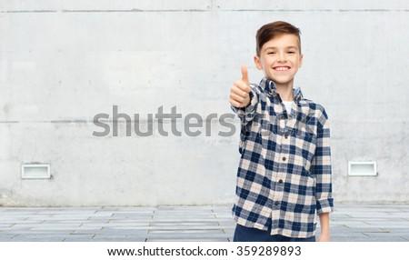 Souriant garçon à carreaux shirt Homme sexe Photo stock © dolgachov