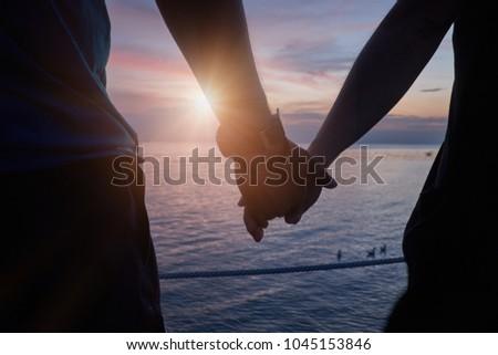 Couple sat on a beach Stock photo © IS2