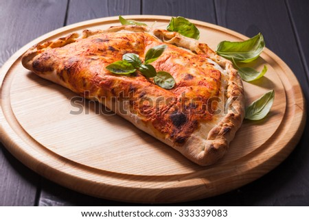Delicious hot Calzone pizza  On a plate Stock photo © fanfo