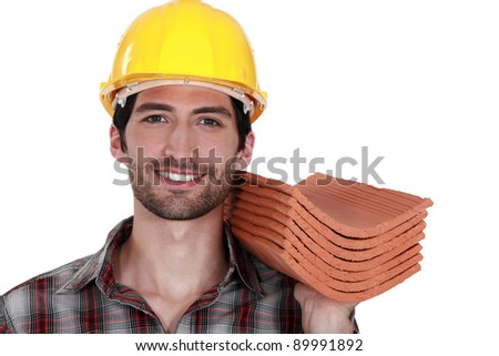 tradesman holding a stack of tiles stock photo © photography33