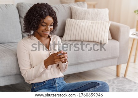 Woman sitting on floor,  texting Stock photo © IS2
