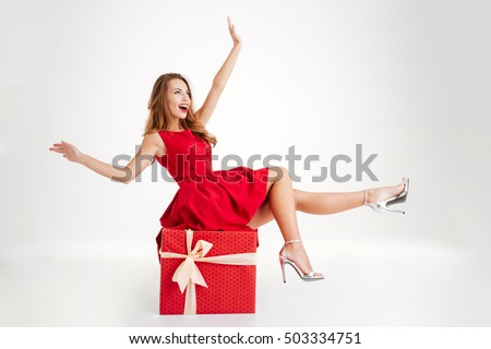 happy woman with christmas present stock photo © kurhan