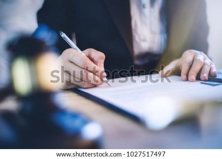 Hand of businessman holding a legal document. Stock photo © RAStudio