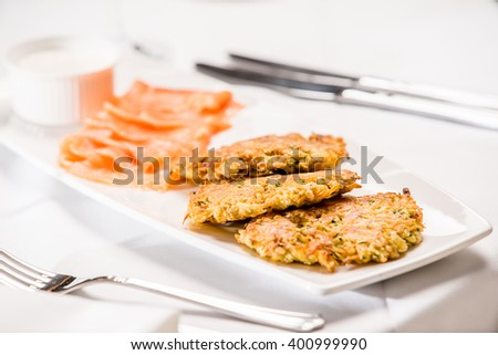 Zucchini fritters with salmon Stock photo © YuliyaGontar