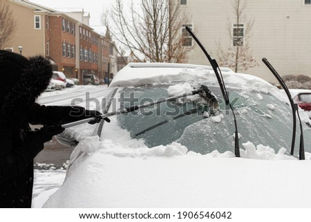 Thick Coat And Gloves In Snowy Weather Stock photo © stuartmiles