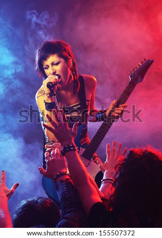 Female singer in a rock band Stock photo © photography33