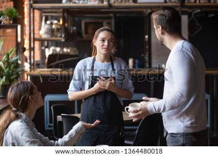 Indignant waitress. Stock photo © Fisher