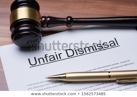 Documents Of Unfair Dismissal With Gavel And Pen Stock photo © AndreyPopov