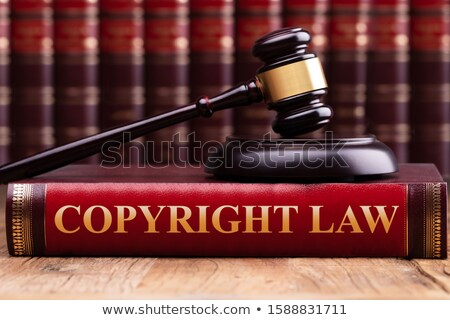 Copyright Law Book And A Judge Gavel On Desk Stock photo © AndreyPopov